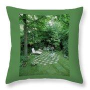 A Garden With Checkered Pavement Throw Pillow