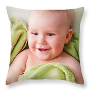 A Happy Baby Lying On Bed In Green Towel Throw Pillow