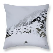 A Hiker Approaches A Snowy Peak Covered Throw Pillow