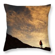 A Hiker Standing On A Ridge At Sun Rise Throw Pillow
