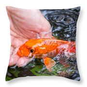 A Koi In The Hand Throw Pillow