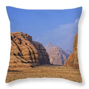 A Landscape Of Rocky Outcrops In The Desert Of Wadi Rum In Jordan Throw Pillow by Robert Preston