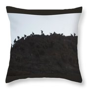 A Line Of People Walking On A Mountain Throw Pillow