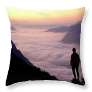 A Lone Hiker Above The Clouds Throw Pillow