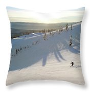 A Lone Skier Makes A Turn At Whitefish Throw Pillow