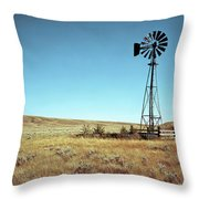 A Lone Windmill Stands On The Canadian Throw Pillow