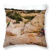 A Male And Female Mountain Biker Ride Throw Pillow