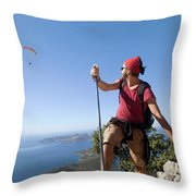 A Male Climber Looking At Paragliding Throw Pillow