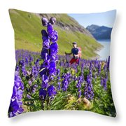 A Male Hiker In Sunny Flower Field Throw Pillow