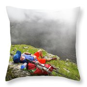 A Male Hiker Is Resting In A Grassy Throw Pillow
