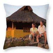 A Man And Woman Enjoy Sunset Throw Pillow