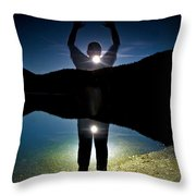 A Man Balances On A Log At Night Throw Pillow