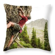 A Man Clinging To Rock Face In The Throw Pillow