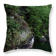 A Man Floats Along In A Kayak Throw Pillow