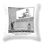 A Man Giving A Ted Presentation Points To An Throw Pillow