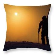 A Man Hikes Up A Mountain At Sunrise Throw Pillow
