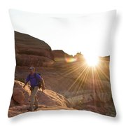 A Man Hiking In The Needles District Throw Pillow