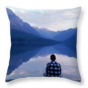 A Man Looks At The Mountains Throw Pillow