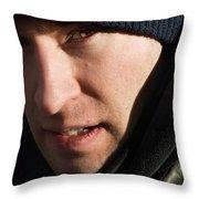 A Man Looks Up After Examining Throw Pillow