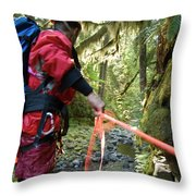 A Man Lowers A Rope For Canyoning Throw Pillow