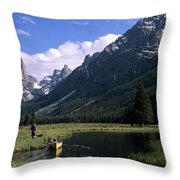 A Man Pulls His Canoe Up A River Valley Throw Pillow