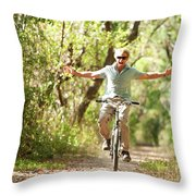 A Man Rides A Bicycle Throw Pillow