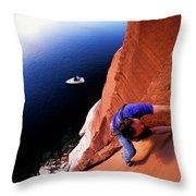 A Man Rock Climbing Throw Pillow