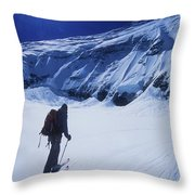 A Man Ski Touring Under Blue Skies Throw Pillow