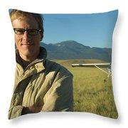 A Man Stands In A Field Next Throw Pillow