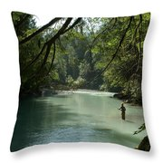 A Man Stands In A River Wearing Waders Throw Pillow