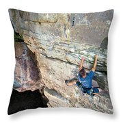 A Man Tackles An Overhanging Sandstone Throw Pillow