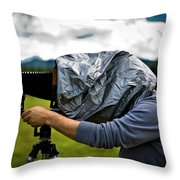 A Man Takes A Photograph With His Large Throw Pillow