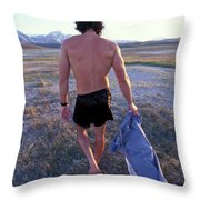 A Man Takes Off His Clothes And Walks Throw Pillow