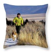 A Man Trail Runs On A Winter Day Throw Pillow