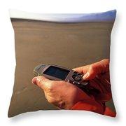 A Man Using A Gps Device At Sunset Throw Pillow