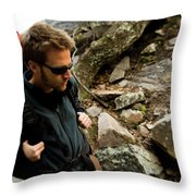 A Man Wearing A Backpack Hikes Throw Pillow