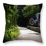 A Man With A Bike Standing On The Front Throw Pillow