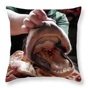 A Meat Seller Shows Off A Cow Snout Throw Pillow