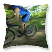 A Mountain Biker Races On A Trail Throw Pillow