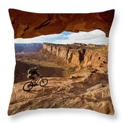 A Mountain Biker Rides By On Slickrock Throw Pillow