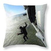 A Naval Air Crewman Jumps From An Throw Pillow