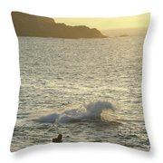 A Person Hiking On Rocky Shore Throw Pillow