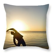 A Person Practices Yoga At The Waters Throw Pillow