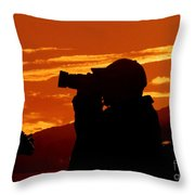 A Photographer Enjoying His Work Throw Pillow