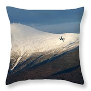 A Plane Flies In The Distance Over Mt Throw Pillow
