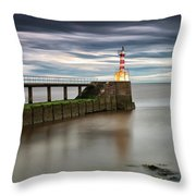 A Red And White Striped Lighthouse Throw Pillow