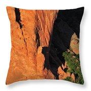 A Rock Climber In A Blue Shirt Climbing Throw Pillow