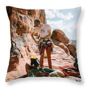 A Rock Climber Setting Up To Climb Throw Pillow