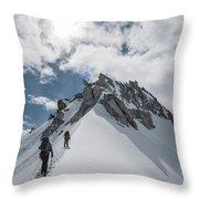 A Rope Team Climbs A Ridge Throw Pillow