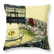 A Round Couch And A Birdcage Throw Pillow